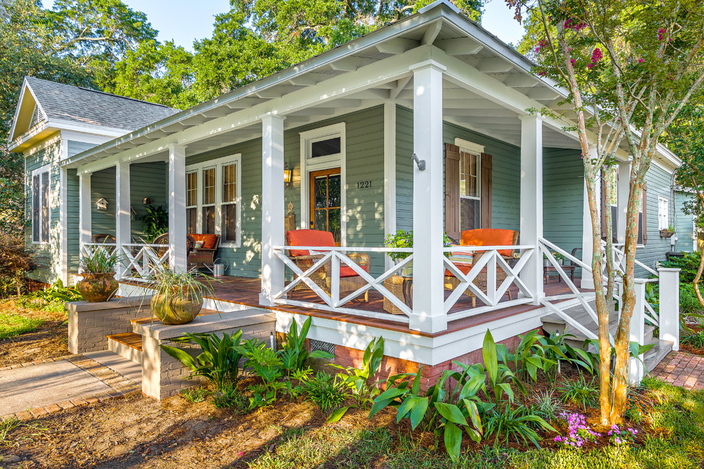 Porch Railing Ideas Porch Traditional with Green Siding Landscaping Orange Cushions Outdoor Furniture1