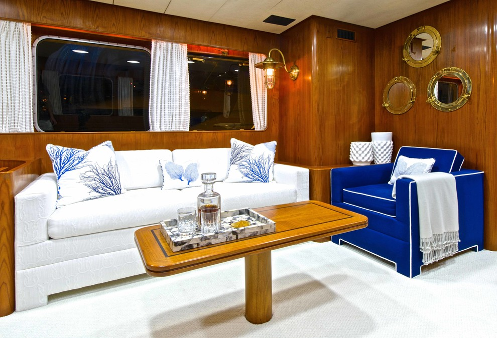 Porthole Mirror Living Room Beach with Blue and White Pillows Blue Armchair Boat