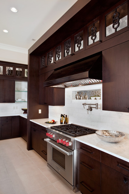 pot filler faucet Kitchen Contemporary with built ins calacatta gold marble dark wood cabinets kitchen