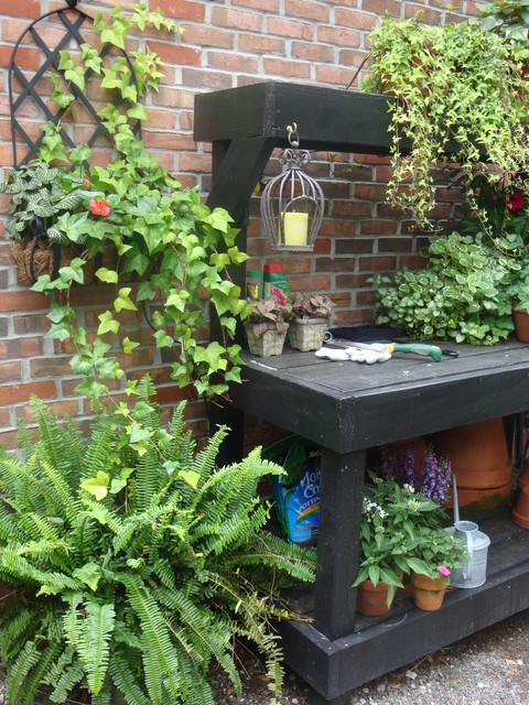 Potting Benches Exterior Traditional with Black Painted Planting Table Brick Candles Ferns Gravel Ivy