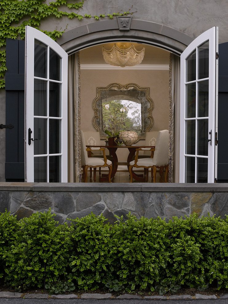 Quatrefoil Mirror Dining Room Traditional with Arch Doorway Boxwood Landscaping Climbing Plants Dining