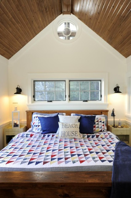 quilted pillow shams Bedroom Rustic with bedside tables blue accents cathedral ceiling circle window cottage