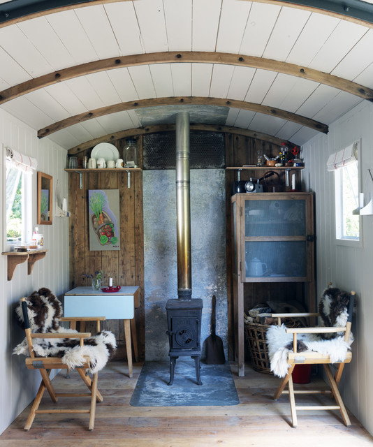 Quonset Building Living Room Shabby Chic with Beadboard Chair Curved Ceiling Fireplace Pine Rustic Rustic Wood