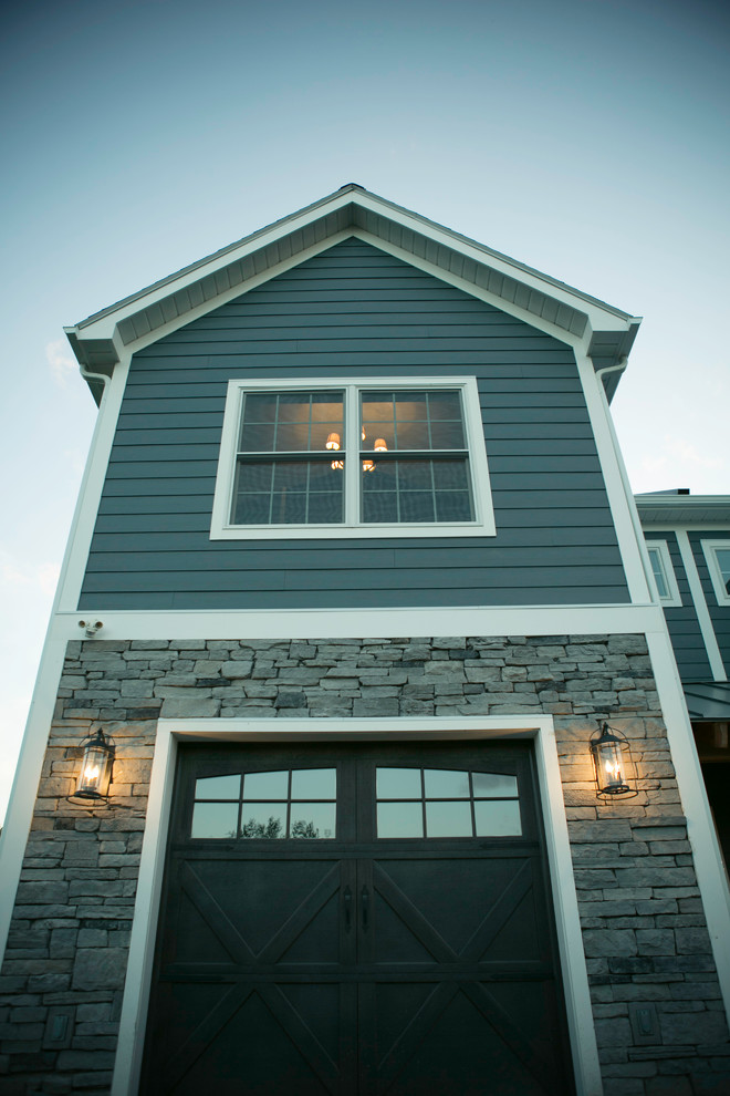 Quonset Hut Homes Exterior Traditional with Carriage Doors Ledgestone
