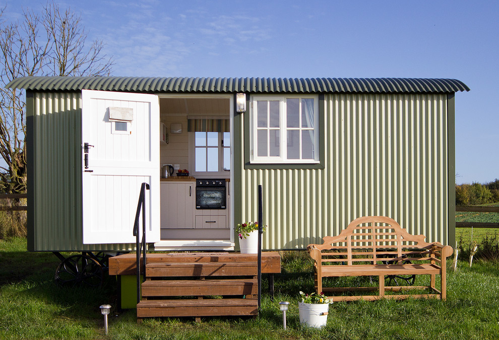 Quonset Hut Homes Garage and Shed Farmhouse with Caravan Corrugated Metal Garden Bench Garden Rooms