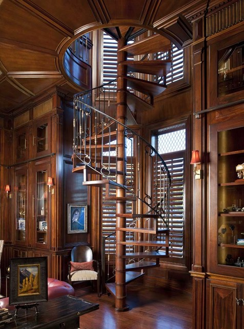 reclaimed wood dallas Staircase Traditional with built-in cabinets glass cabinets gothic iron railing iron spiral