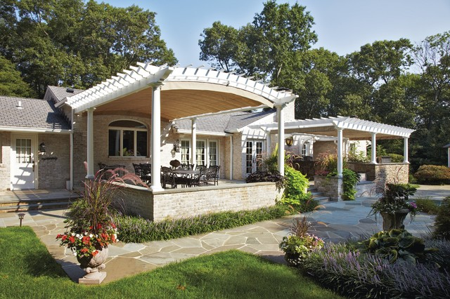 Retractable Awning Patio Traditional with Arched Pergola Brick Flagstone Landscaping Lavender Motorized Canopy Outdoor
