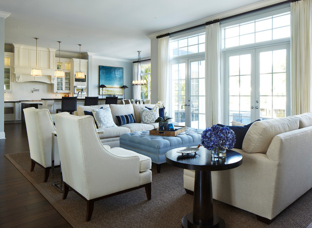 rizzy rugs Living Room Traditional with beige sofa blue tufted ottoman dark wood flooring french