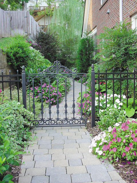 Rod Iron Fence Landscape Traditional with Brick Siding Concrete Flowers Ivy Pathway Patios Pavers Stone