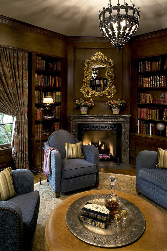 Round Leather Ottoman Family Room Victorian with Blue Armchairs Bookcase Bookshelves Built in Shelves