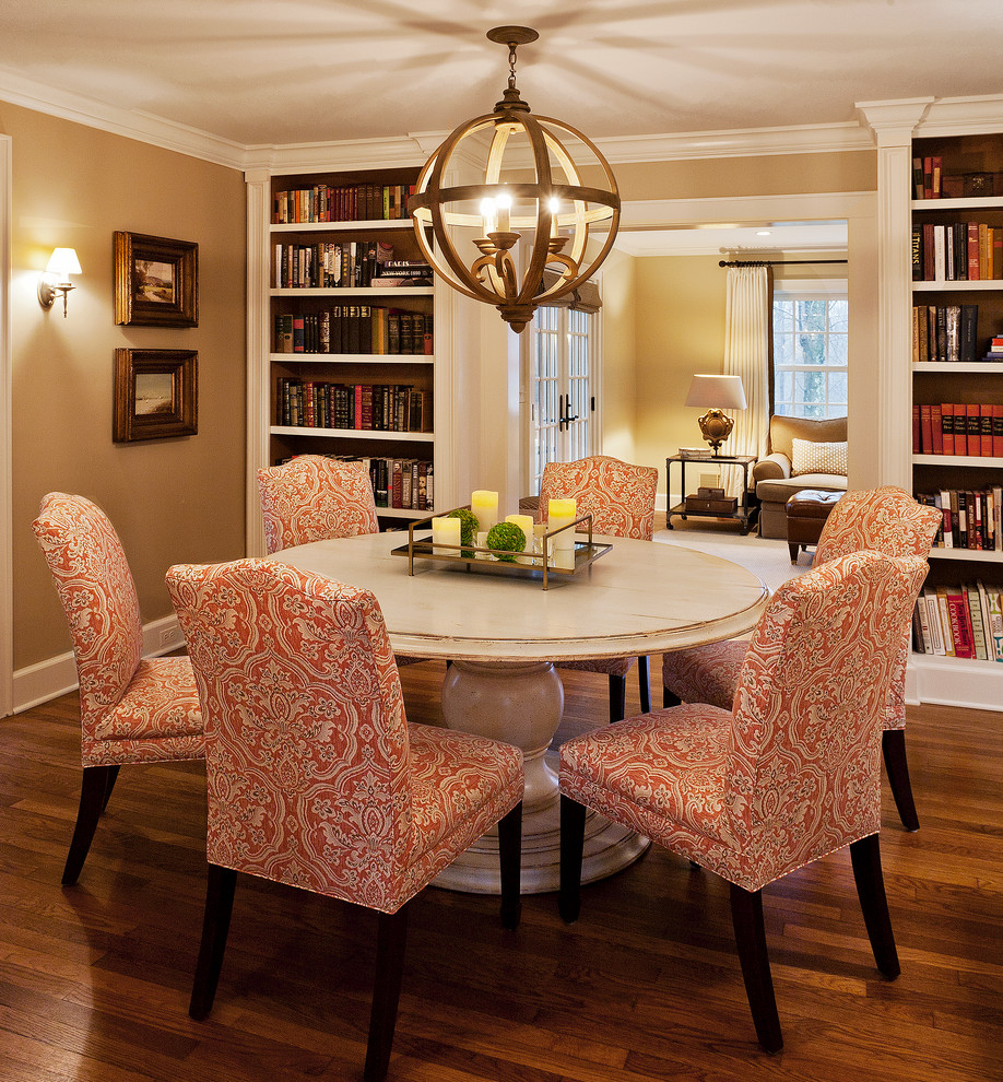 Round Pedestal Dining Table Dining Room Traditional with Beige Walls Book Shelves Bookcases Crown Molding1