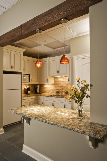 Ruff Hewn Spaces Traditional with Brick Backsplash Cream Cabinets Distressed Cabinets Fir Beam Granite