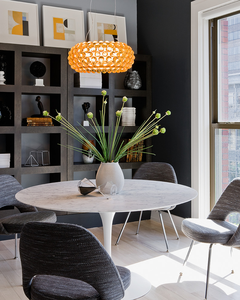Saarinen Chair Dining Room Contemporary with Artwork Black Walls Bookshelves Chandelier Contemporary Contemporary