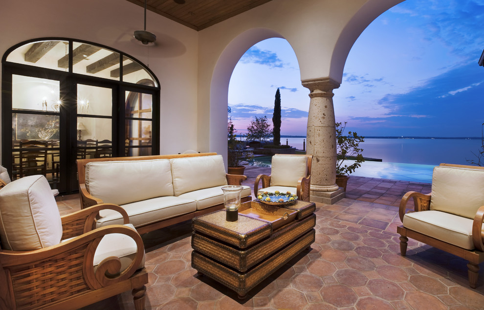 Saltillo Tile Patio Mediterranean with Arch Ceiling Fan Column Columns Exotic Exposed