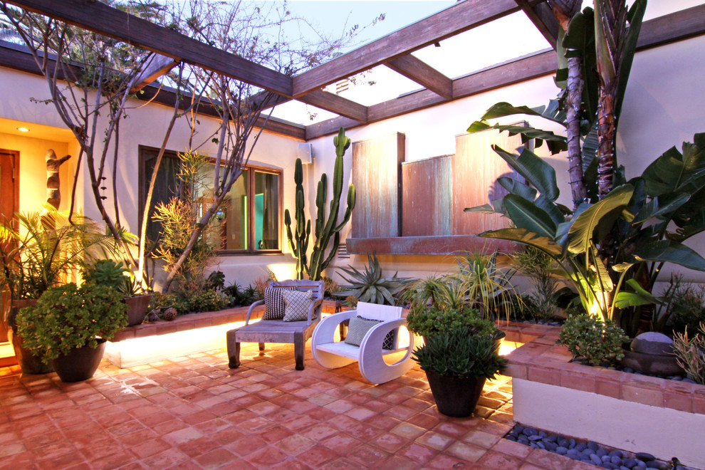 Saltillo Tile Patio Tropical with Covered Entry Landscaping Lounge Chair Outdoor Seating