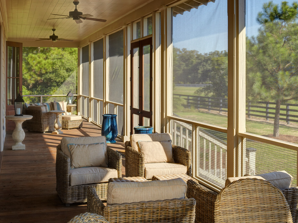 Screened Porch Ideas Porch Traditional with Blue Urn Ceiling Fan Cube Table Cushy