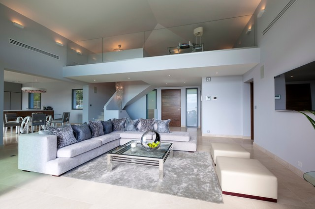 Settee Cushions Living Room Contemporary with Area Rug Chrome Glass Coffee Table Glass Panel Railing