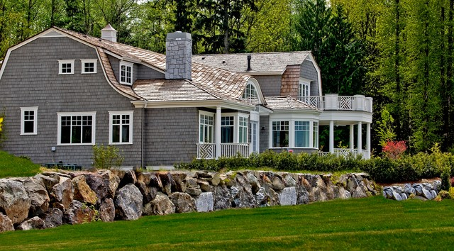 Shake Siding Exterior Victorian with Arched Window Bay Window Boulder Wall Cape Cod Cottage