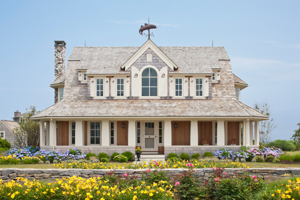 Shutter Dogs Exterior Beach with Arched Window Covered Porch Landscaping Shingle Siding
