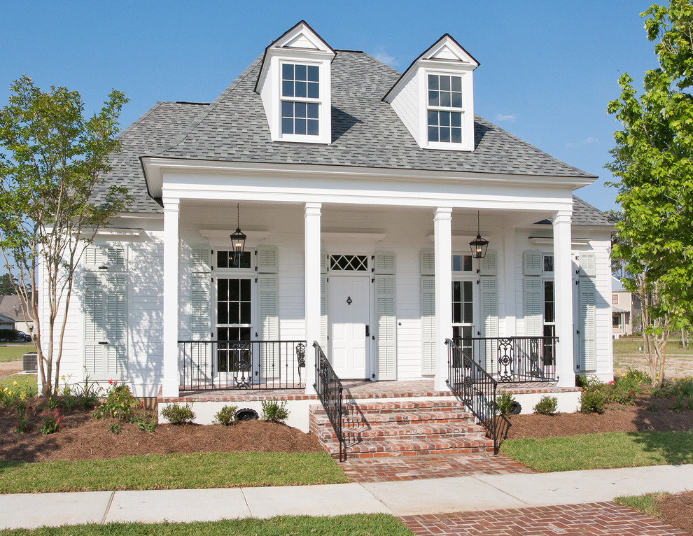 shutter dogs Exterior Traditional with black metal railing brick steps front porch