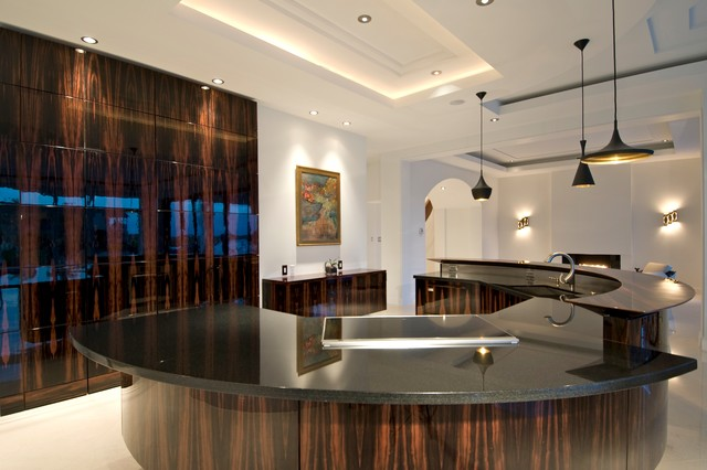 Simmons Sectional Kitchen Contemporary with Arched Doorway Artwork Cove Lighting Dark Stained Wood Fireplace