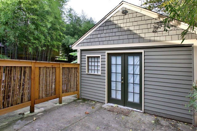 Sisters Oregon Real Estate Garage and Shed Traditional with Bamboo Bamboo Fence Beige Trim Bungalows Concrete Patio Glass