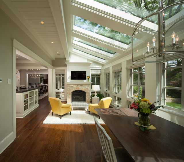 Skylight Shades Sunroom Transitional with Area Rug Breakfast Room Chandelier Dining Table Recessed Lighting
