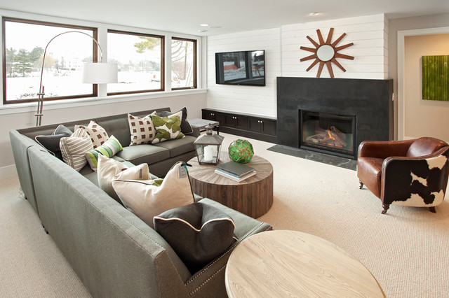 Soapstone Fireplace Basement Transitional with Arched Floor Lamp Beige Carpet Brown Leather Armchair Built In