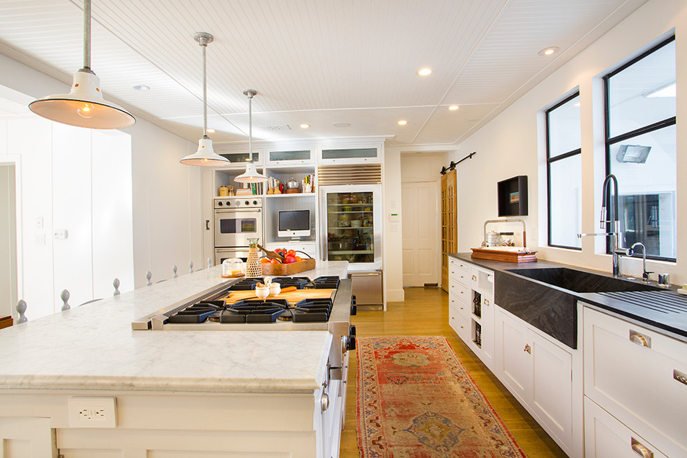 soapstone sink Kitchen Eclectic with appliance wall barn light pendants beadboard ceiling