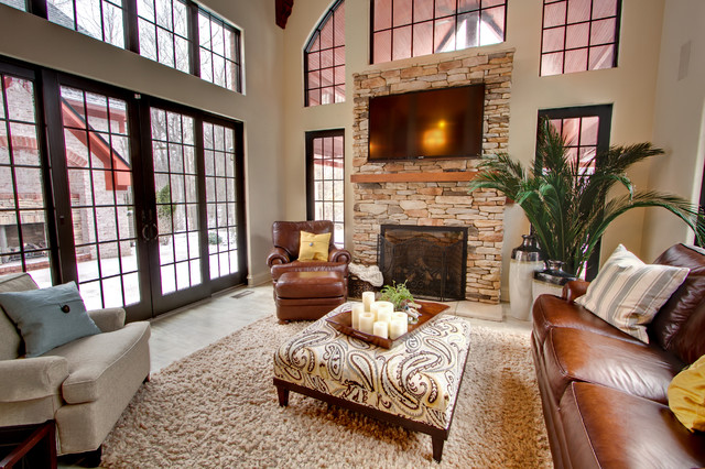 Square Leather Ottoman Family Room Traditional with Arched Window Area Rug Beige Brown Leather Club Chair