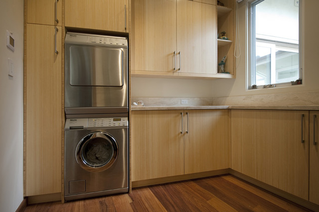 Stacked Washer and Dryer Laundry Room Contemporary with Blonde Wood Built in Storage Front Load Washer And1