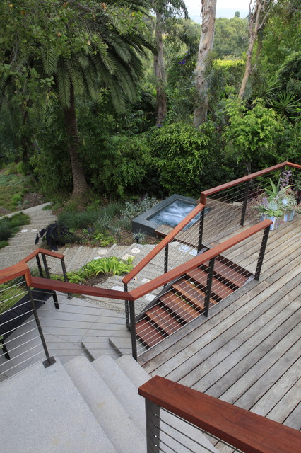 Stainless Steel Cable Railing Landscape Modern with Cable Railing Concrete Pavers Gravel Jacuzzi Lush Lush Backyard