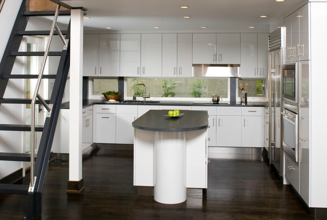stainless steel griddle Kitchen Contemporary with curved Custom Cabinetry dark stained wood glass gray high
