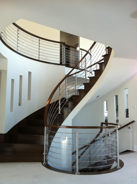 stainless steel railing Staircase Modern with curved staircase dark wood staircase dark wood stairs metal