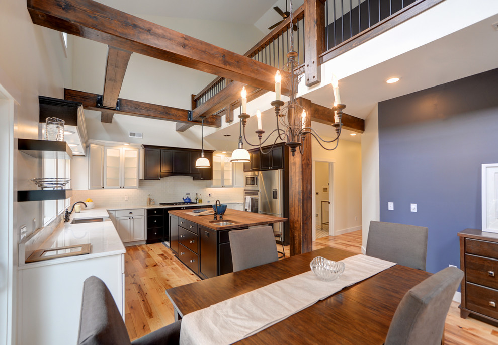 Stair Spindles Dining Room Transitional with Accent Wall Exposed Beams Exposed Wood Beams