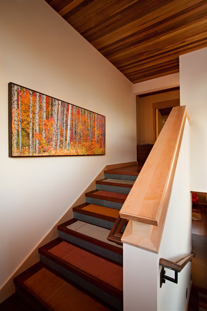 stair treads carpet Staircase Rustic with artwork cabin lodge neutral colors rustic sloped ceiling wall