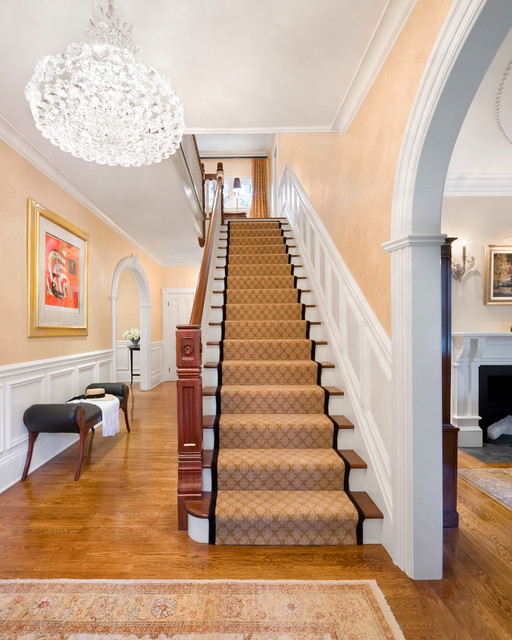 Stair Treads Carpet Staircase Traditional with Archway Area Rug Black Leather Bench Chaise Crystal Chandelier