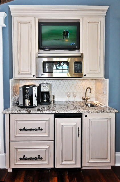 Stand Alone Ice Maker Kitchen Mediterranean with Baseboards Butler Pantry Dark Floor Distressed Finish Granite Countertops