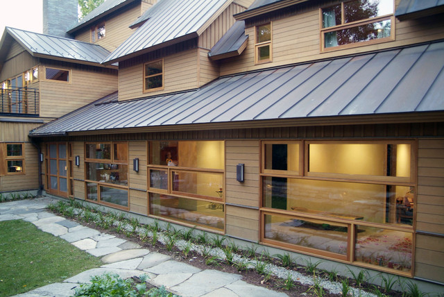 standing seam roof Exterior Rustic with cedar entrance entry glass glass door grass lawn outdoor