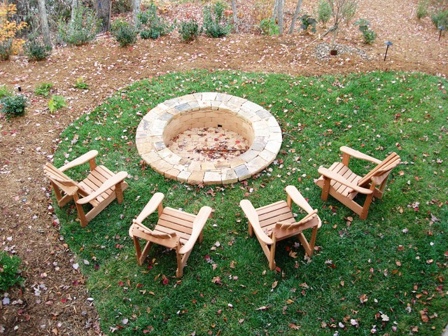 Steel Fire Pit Ring Landscape Rustic with Adirondack Chairs Backyard Retreat Bark Mulch Camp Style Fire
