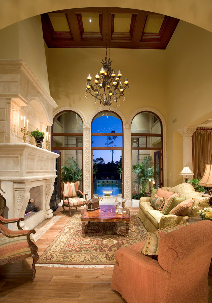 Stone Fireplace Mantels Living Room Mediterranean with Archway Balcony Beige Sofa Beige Wall Coffered