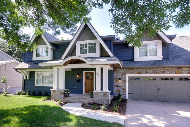 stone veneer siding Exterior Traditional with blue house carriage doors dormer windows driveway entrance entry