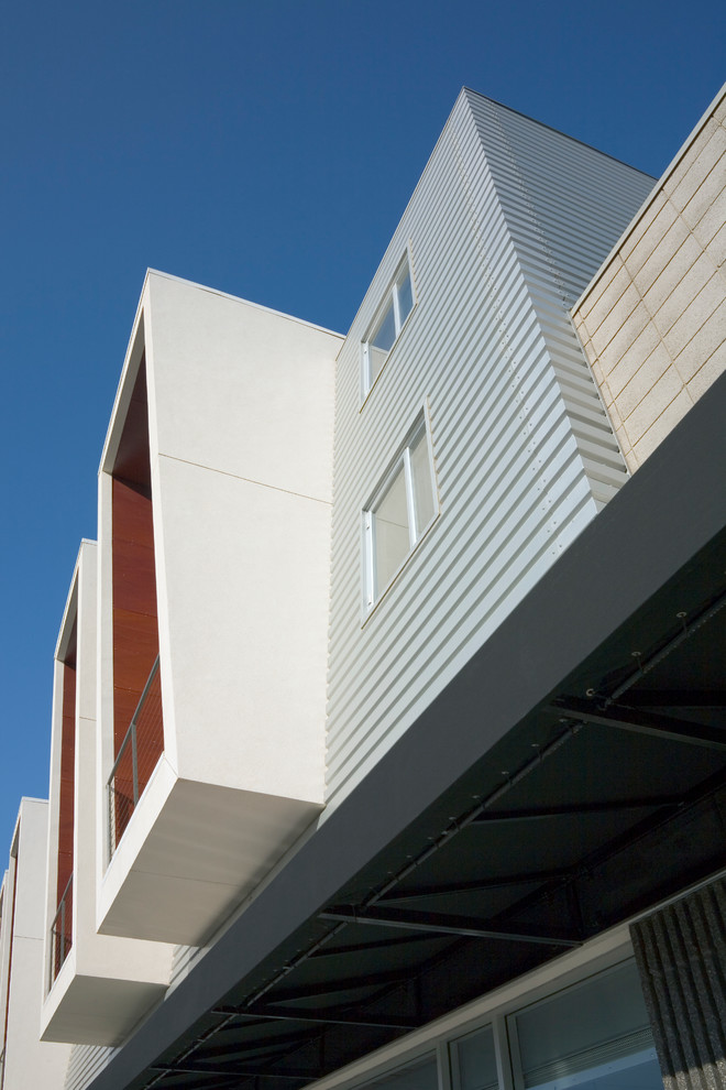 Storehouse Furniture Exterior Modern with 2nd Story Patio Ceiling to Floor Windows