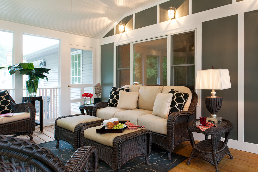 Sunroom Designs Porch Eclectic with Area Rug Ceiling Fan Geometric Pillows Railing1