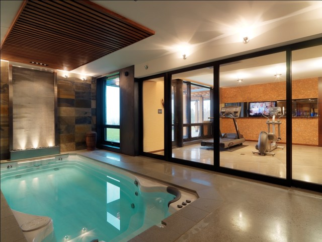 Swimming Pool Basketball Hoop Pool Rustic with Ceiling Treatment Glass Wall Gym Indoor Pool Recreation Room