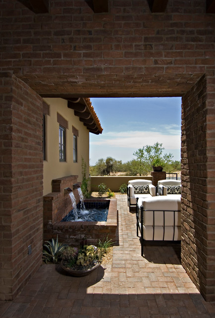 Tabletop Water Fountains Patio Mediterranean with Arm Chairs Brick Pavers Brick Walls Damask Pillows Lintel