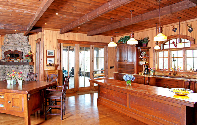 Thomasville lighting kitchen traditional with gray island for Rustic timber frame house plans