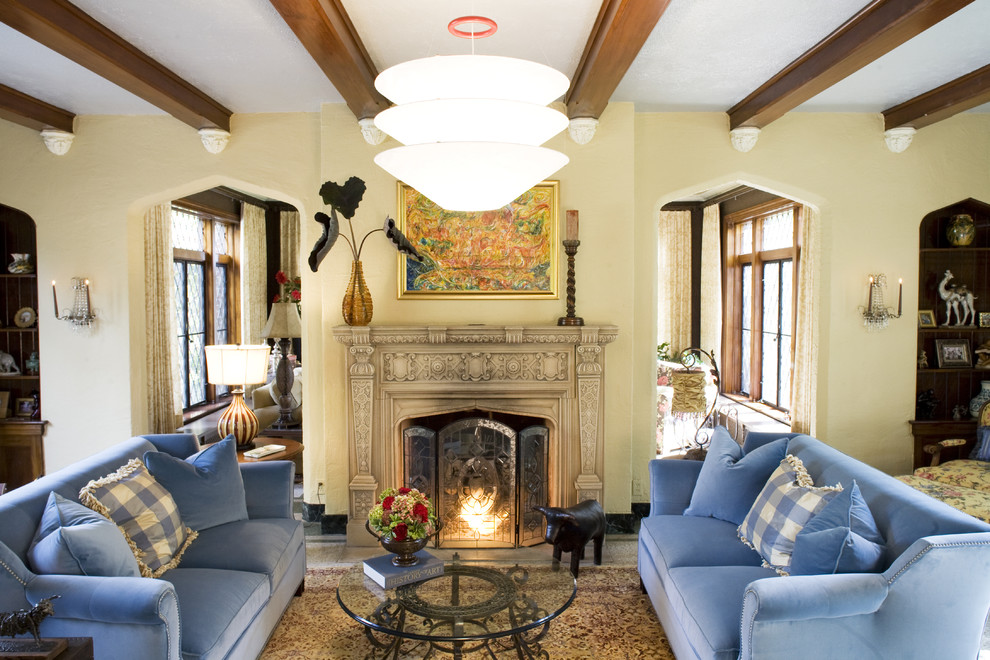 thomasville sofa Living Room Traditional with beams blue sofa candle sconce carved stone