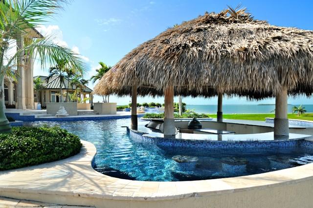 tiki umbrella Pool Tropical with blue columns covered patio grass roof metal roof mosaic