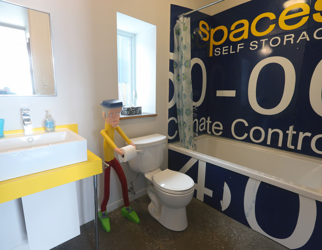 Toilet Paper Dispenser Bathroom Eclectic with Bathtub Comical Concrete Floor Playful Salvaged Sign Shower Curtain